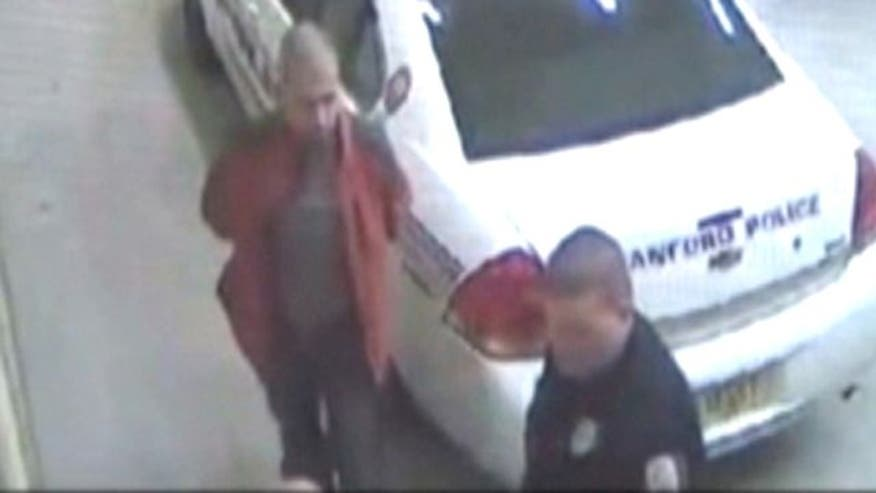 Surveillance cam shows George Zimmerman in police custody shortly after deadly incident