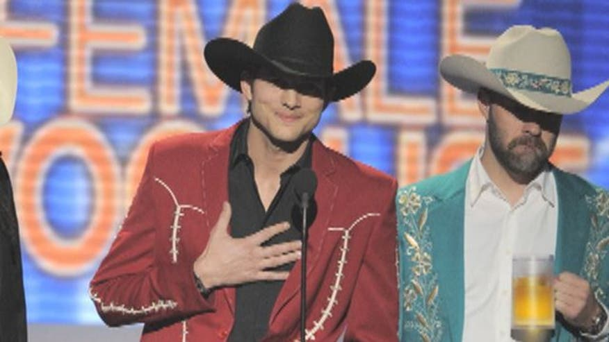 Singer Justin Moore calls Kutcher's ACM appearance 'distasteful,' while some fans say popular country is a mockery of original format