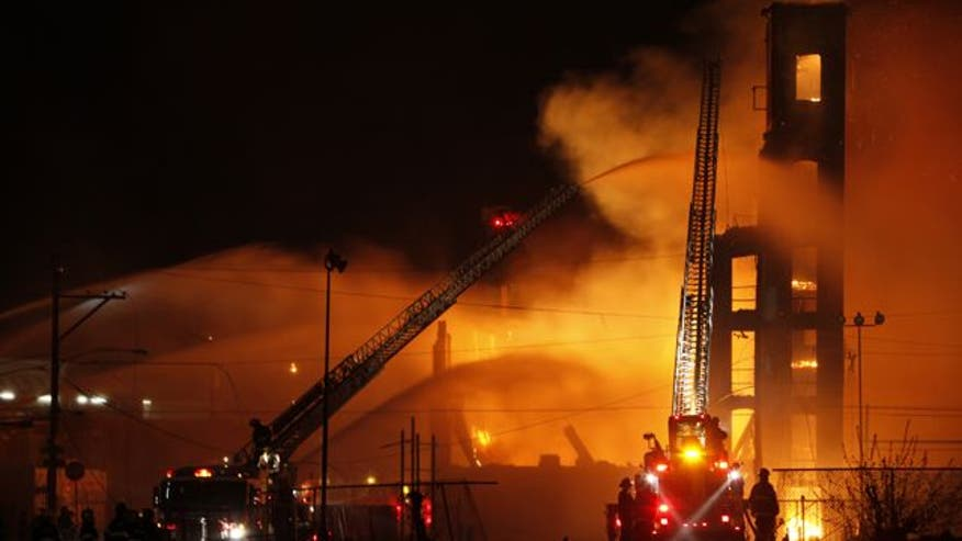 At least two firefighters killed battling blaze in abandoned building