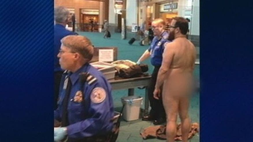 Traveler strips in front of TSA agents