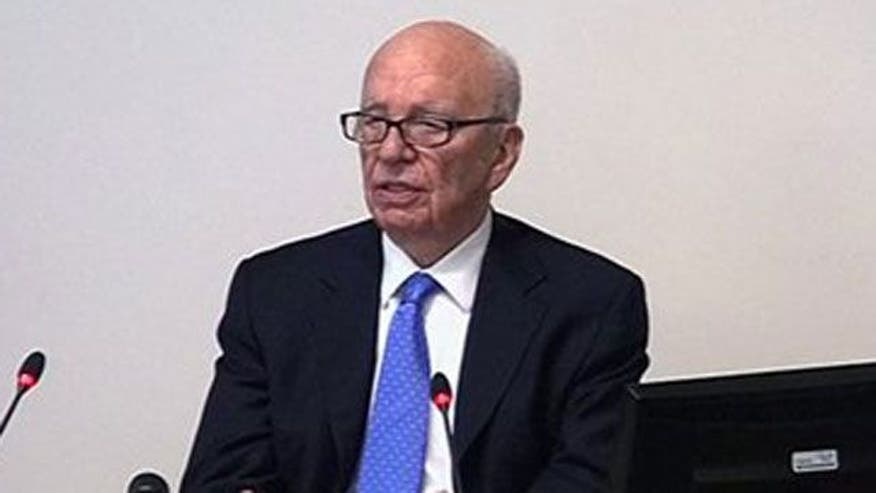 Investigators blame Murdoch, executives