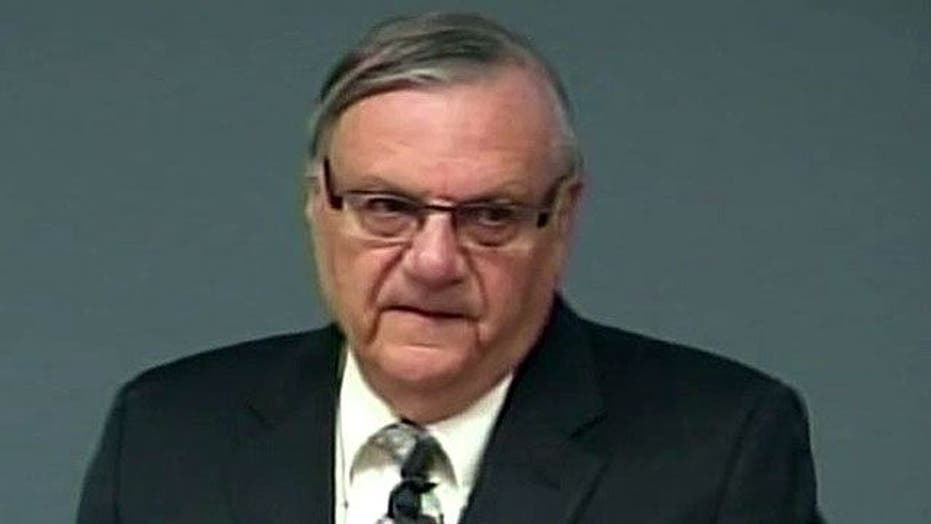 Justice, Arpaio battle over immigration crackdown