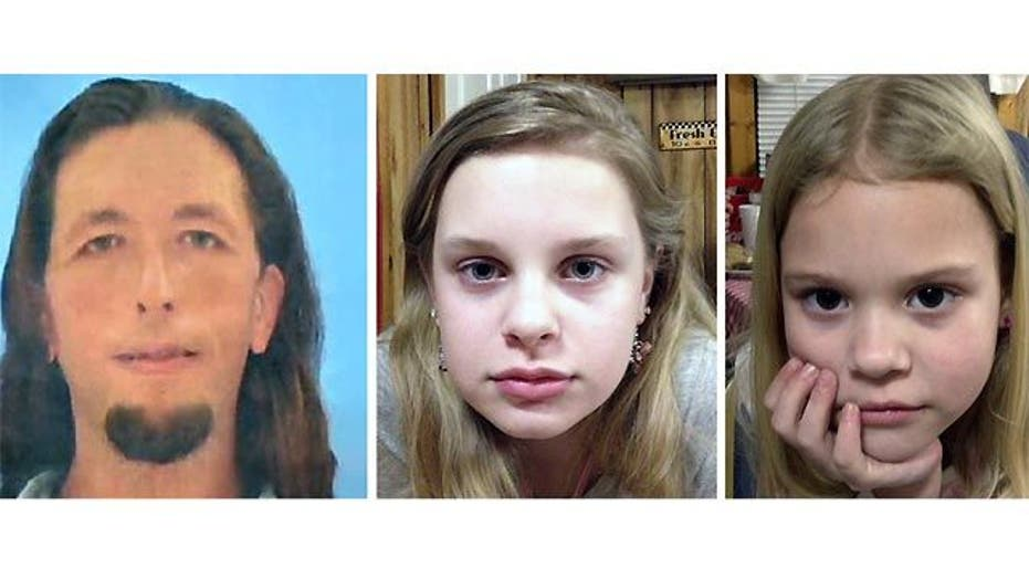 2 girls rescued as manhunt ends