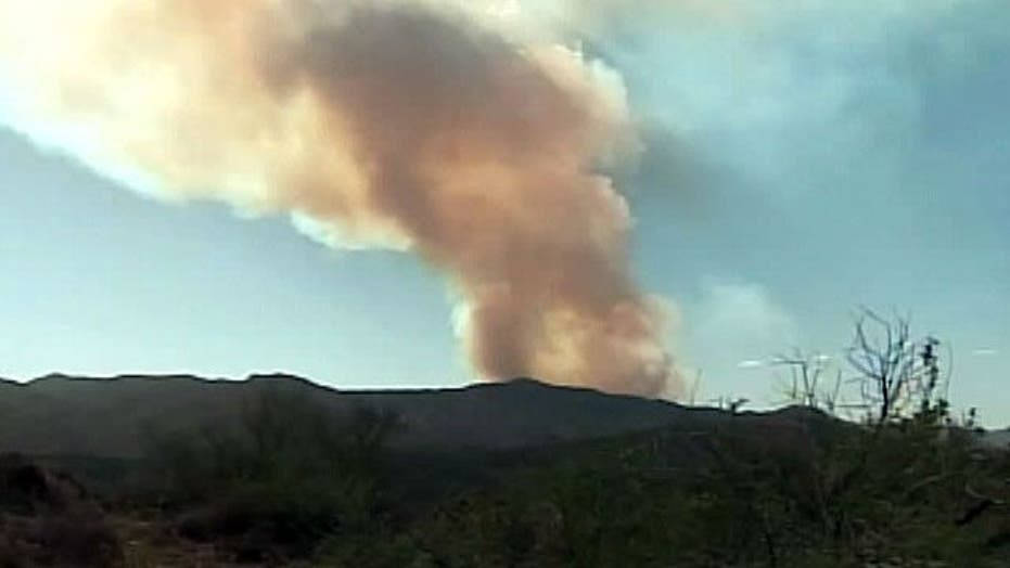 Fire spreads from building to forest in Arizona