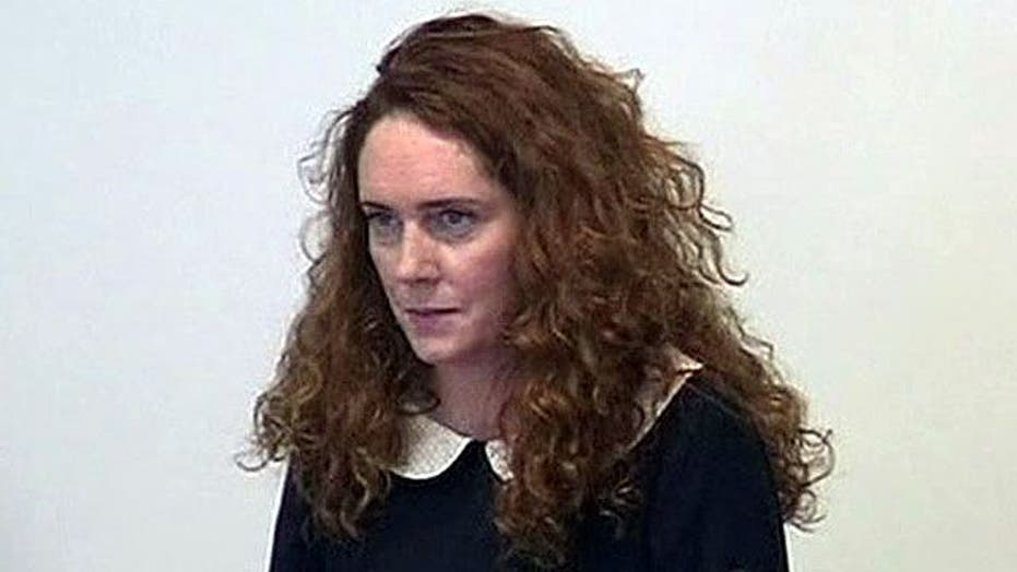 Ex-CEO, husband face charges in U.K. phone hacking scandal