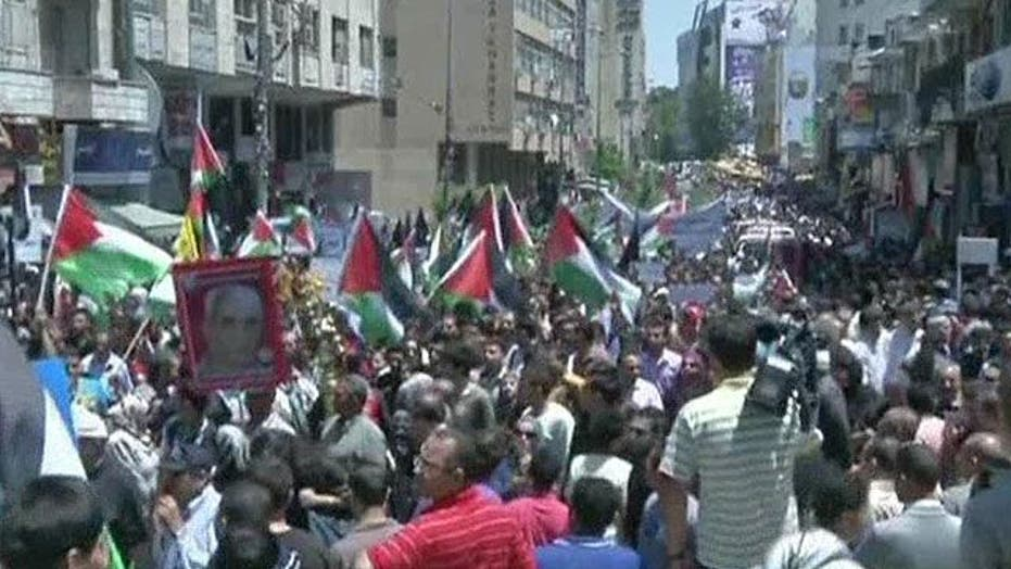 Palestinians march in annual mourning ritual