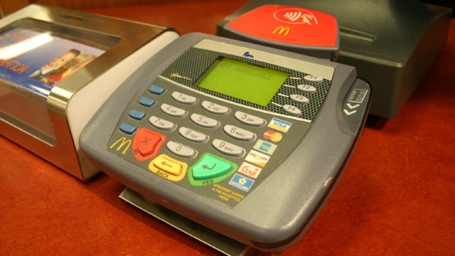 Battle Over Capping Credit Card Fee for Retailers