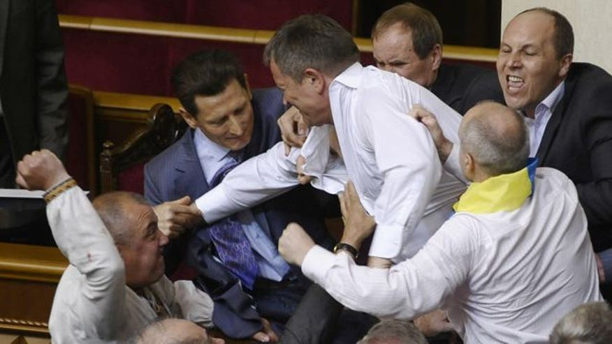 Raw video: Legislators get physical over bill which deals with the use of Russian language in Russian-speaking regions