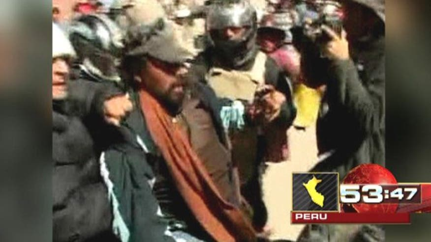 2 killed, dozens injured at protests against mining company
