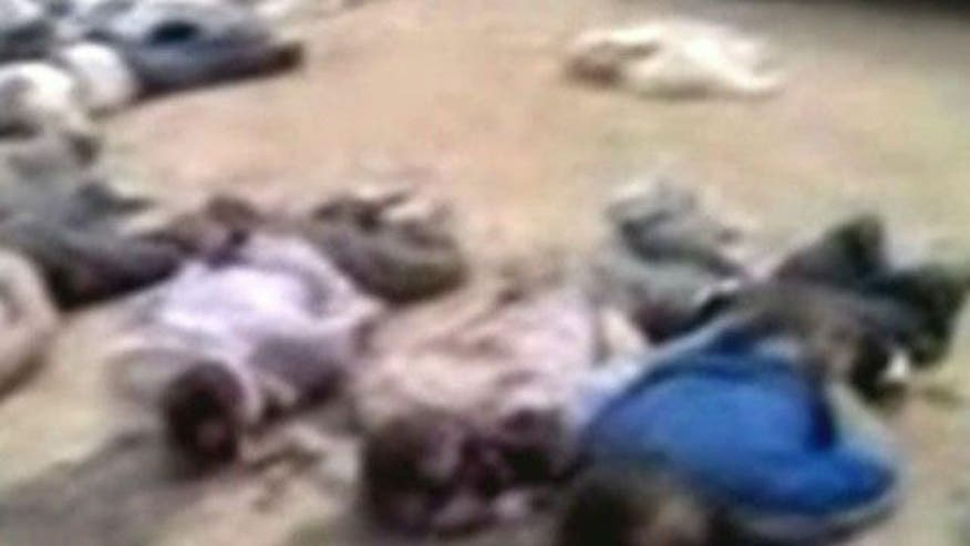 U.S. observers discover 13 bound corpses in Syria