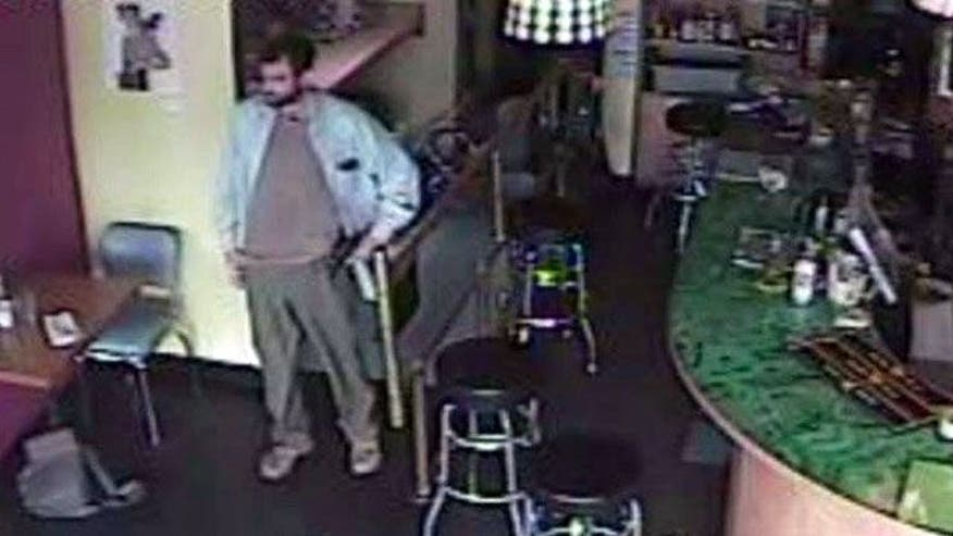 Customer throws chairs at gunman in Seattle