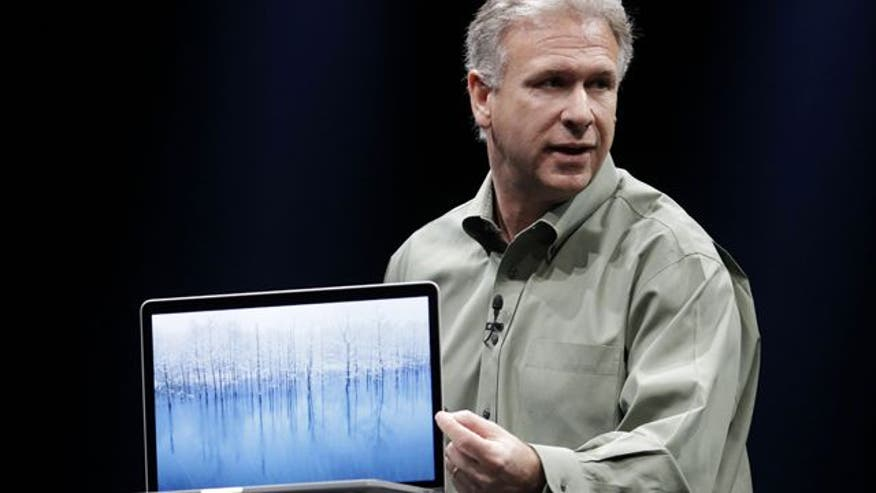 Senior VP Phil Schiller shows off specs of new laptop