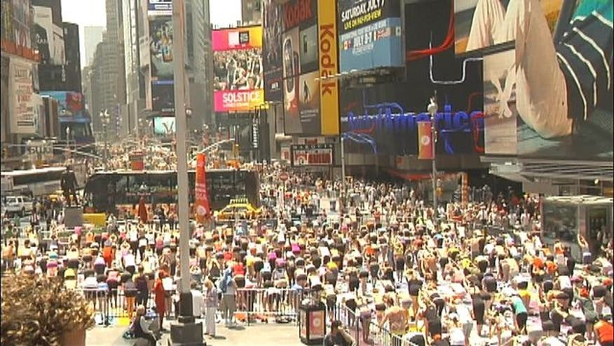 Hundreds gathered to celebrate the summer solstice with some peaceful yoga in the middle one of the world's most hectic places, Times Square.