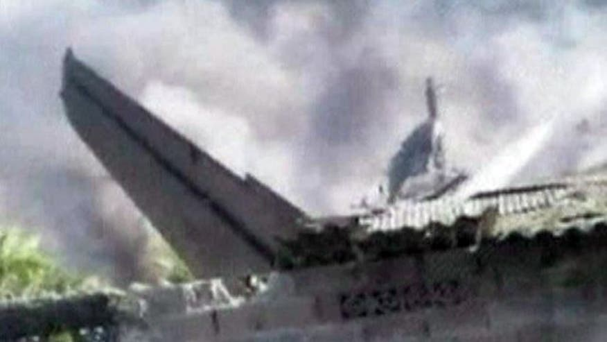 Aircraft hits housing complex leaving at least 10 dead