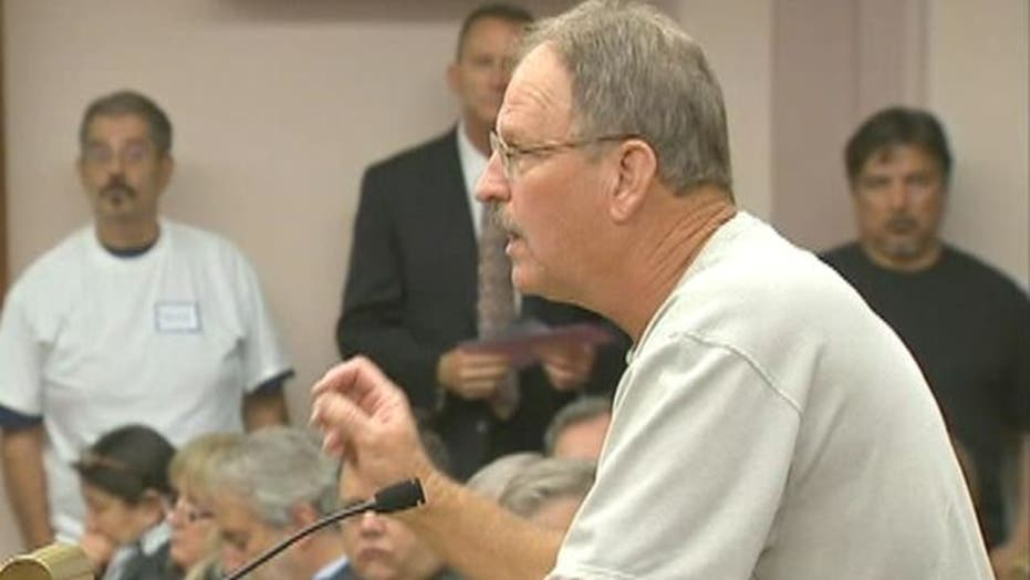 Residents Erupt at Town Meeting