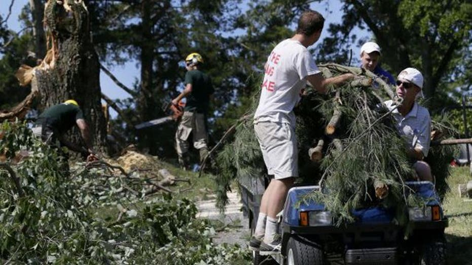 Crews work to clear aftermath of deadly East Coast storms