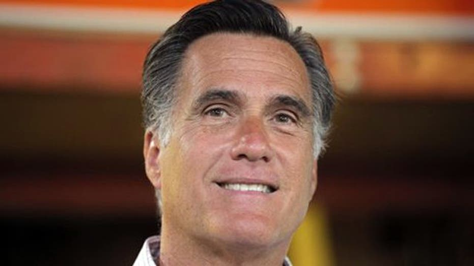 Romney beefs up campaign team
