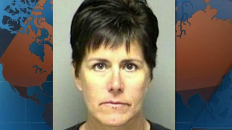 TX principal charged for taping coach in locker room