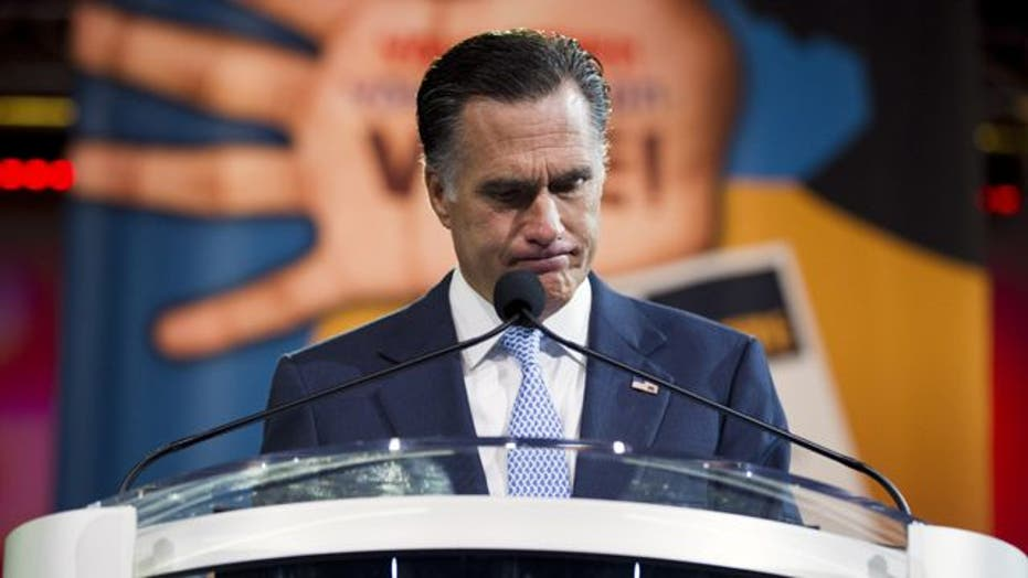 Romney draws boos for vowing to repeal ObamaCare