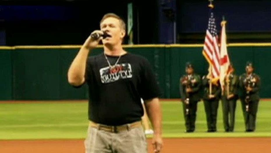 Wrongly convicted man sings National Anthem