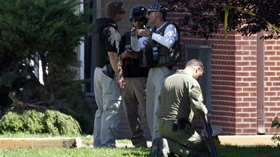 Bomb units disarm explosives inside shooting suspects home