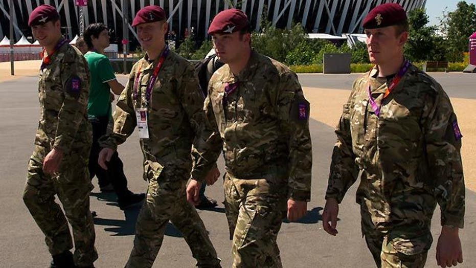 Britain calls up additional troops to guard London Olympics