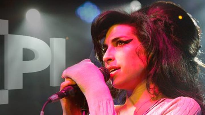 Amy Winehouse's Posthumous Return to Charts