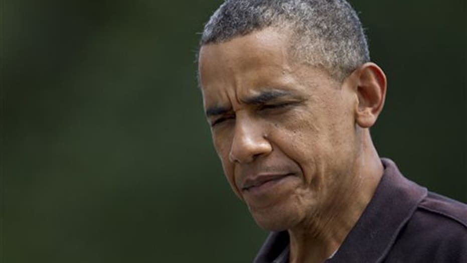 Romney camp calls new Obama ad blitz 'disgusting'