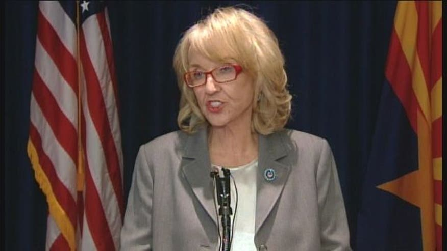 Gov. Jan Brewer signs executive order denying driver's licenses and other public benefits to anyone benefitting from Obama's immigration policy.