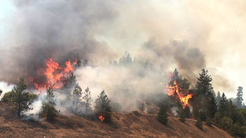 Raging wildfires threaten thousands of homes in California