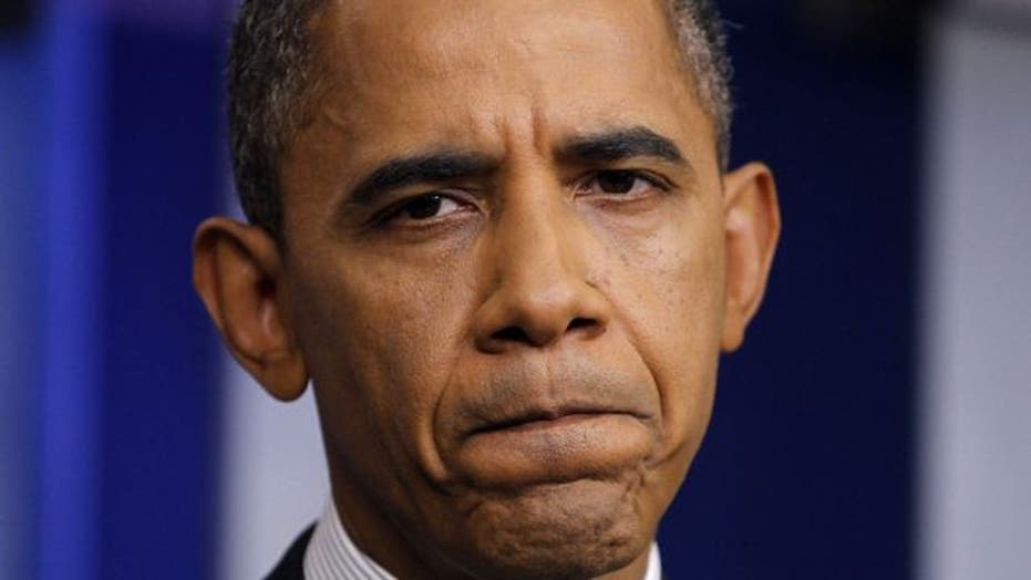 Obama campaign trailing Romney in money race