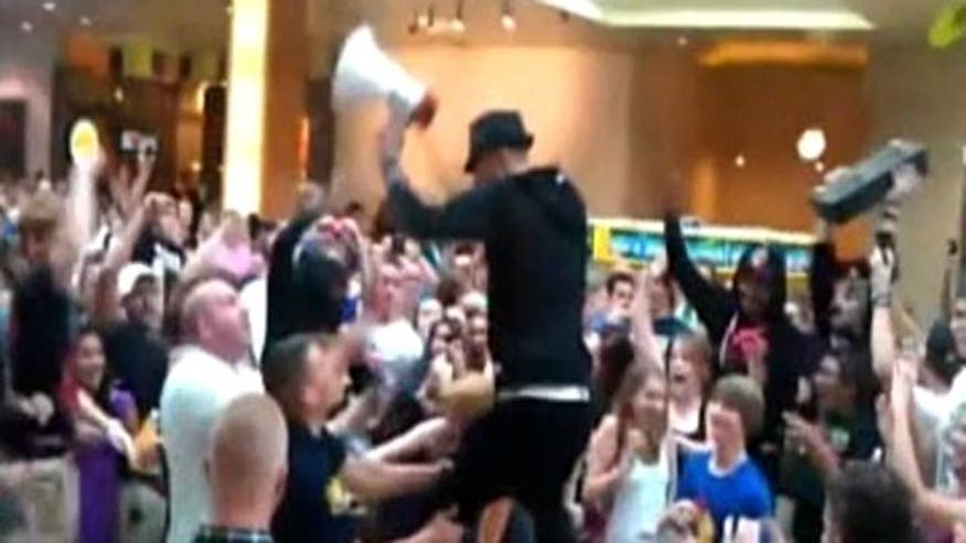 Raw Video: Cleveland's Machine Gun Kelly charged with disorderly conduct after inciting chaotic scene at shopping mall