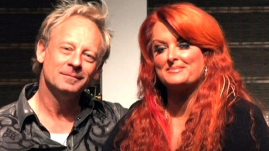 Singer's husband seriously hurt in motorcylce accident; Willie Nelson on the road again; Taylor Swift sets a record; a 12th #1 for Blake Shelton; Country stars sing along to Little Bit Town's summer jam
