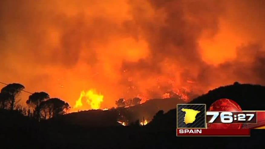 Winds fan flames toward Costa del Sol