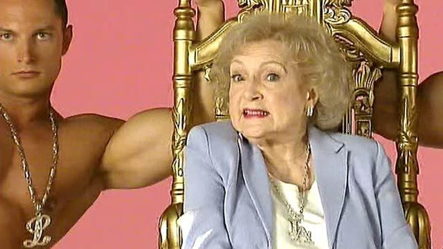 'Golden Girl' surrounded by muscle-bound studs