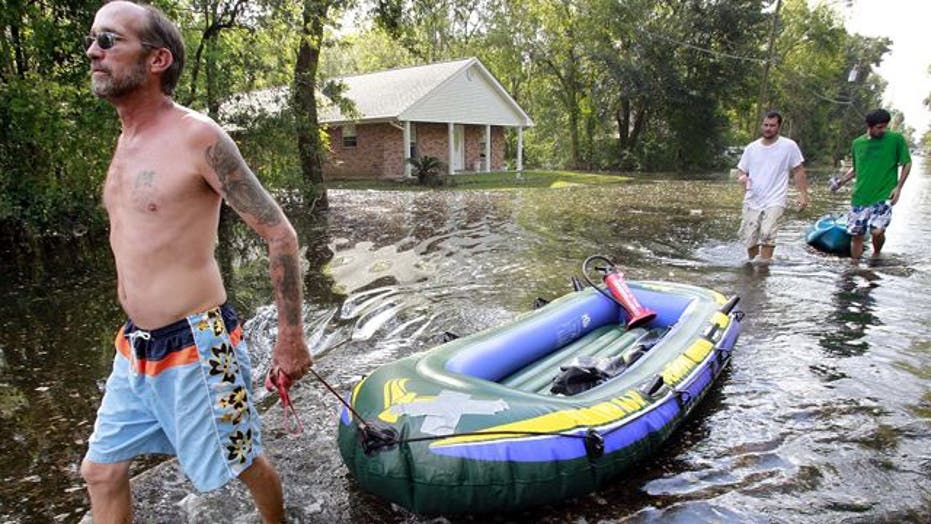 Tens of thousands remain without power days after Isaac