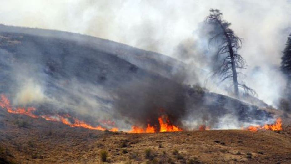 Across America: Wildfire spreads in Wyoming