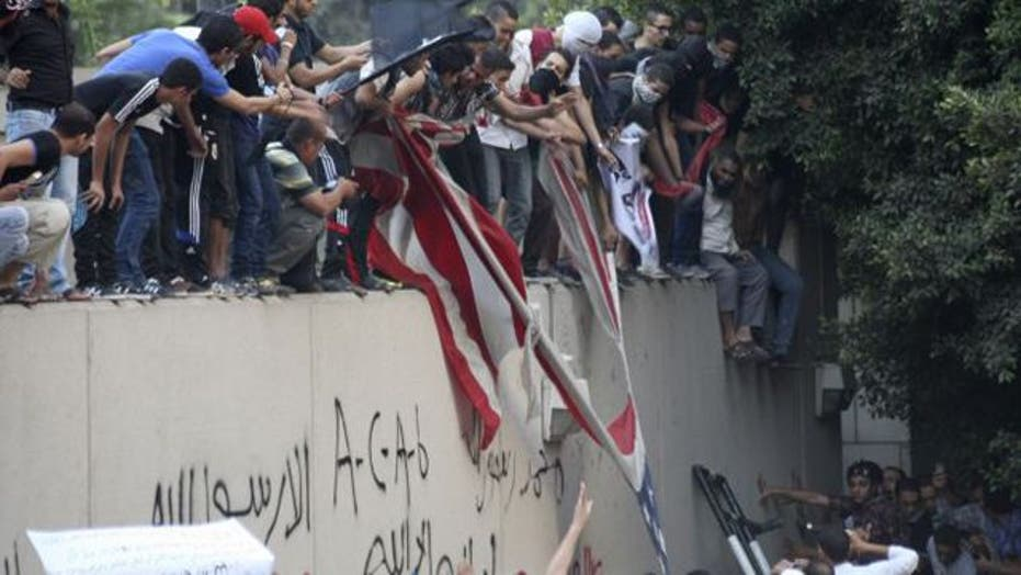 Egyptian protesters scale US Embassy wall