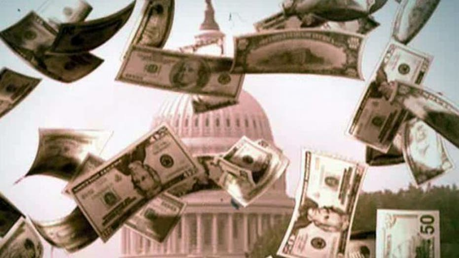 Congress passes spending hike as nation's debt tops $16T