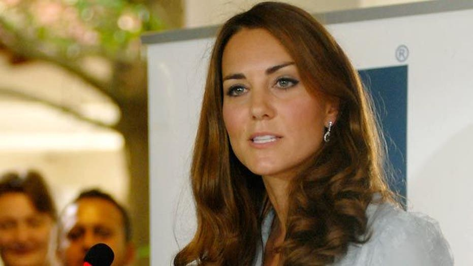 Royal family takes legal action over topless photos