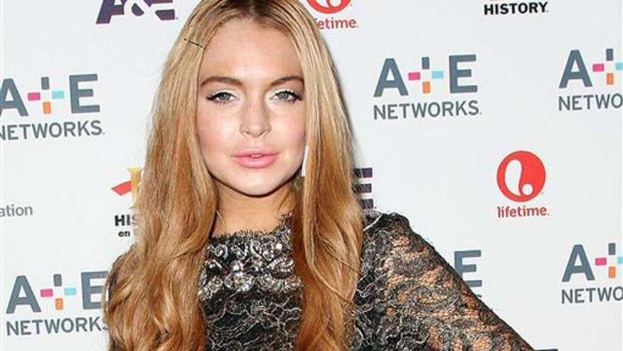 Lindsay Lohan was charged with hitting a pedestrian and then leaving the scene at NYC hotel