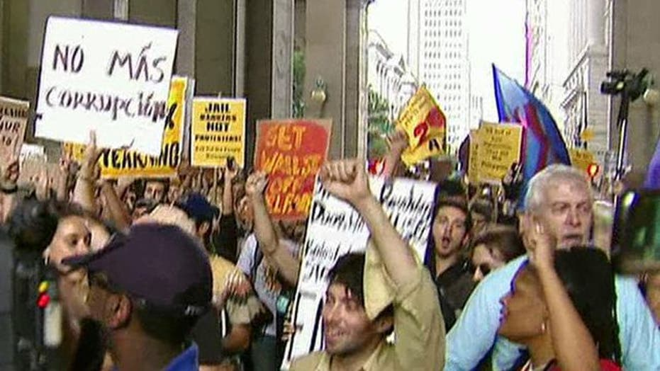Wall Street Protests vs. Tea Party Protests