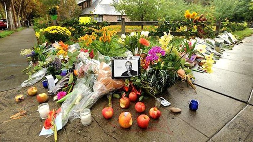 Memorials grow outside company headquarters, co-founder's home