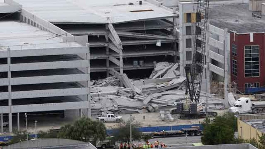 Parking garage crumbles killing two in Miami