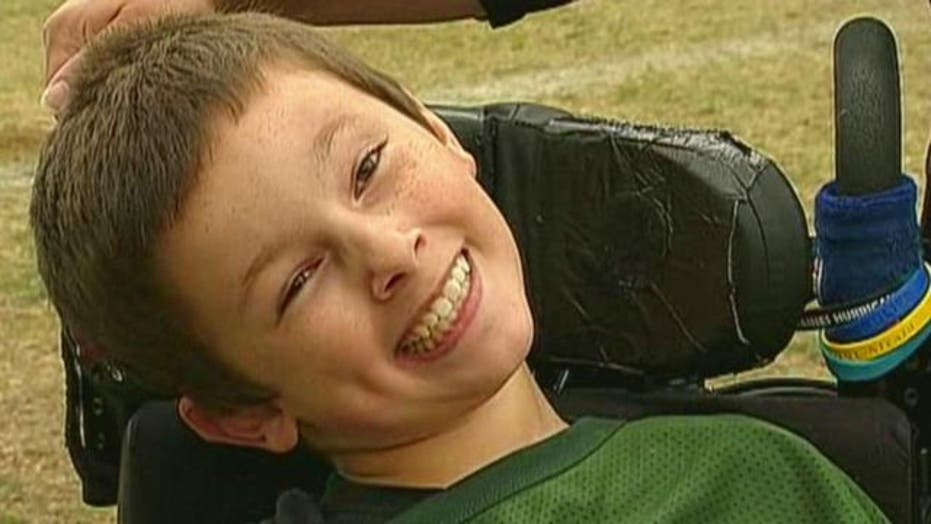 Teen with cerebral palsy scores life-changing touchdown