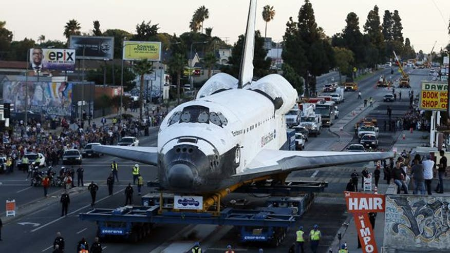 Space shuttle reaches final destination at museum after completing complicated journey through streets of Los Angeles