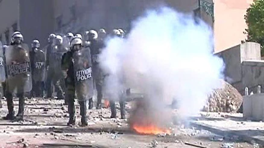 Raw video: Man catches fire during anti-austerity riots