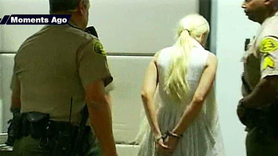 Lindsay Lohan Leaves Court in Handcuffs