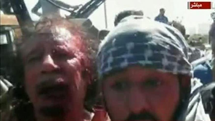Raw footage reportedly shows former Libyan strongman alive after capture