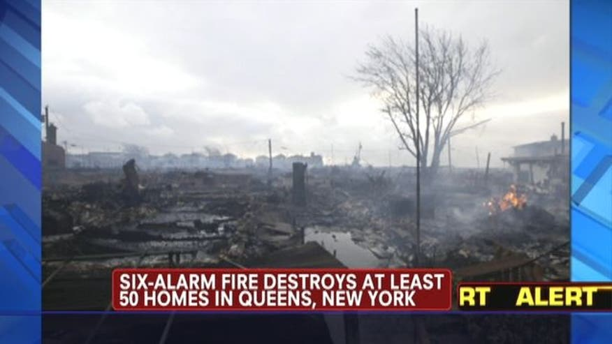 A six-alarm fire destroys at least 50 homes in Queens, New York. Floodwaters prevented firefighters from reaching burning homes in Queens, NY.